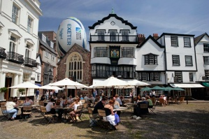 Visitors on Cathedral Green Exeter with over-sized RWC 2015 ball