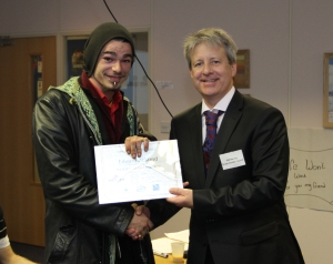 Ed receives his REEP certificate from Dr Phil Norrey